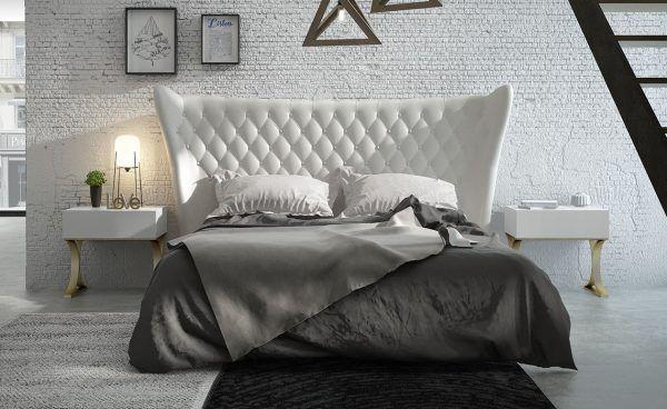 Dormitorio con cabecero capitone